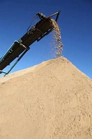 Sand pile and conveyor
