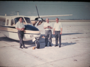 Tom Hagler Jr. (right), Pat Smith (left), and a guest (middle) by the plane in the 60s.